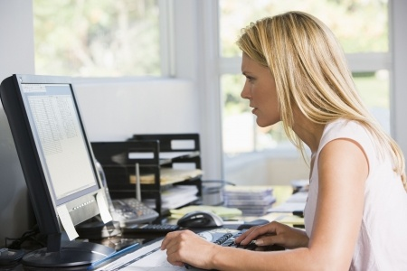 woman working at computer at home